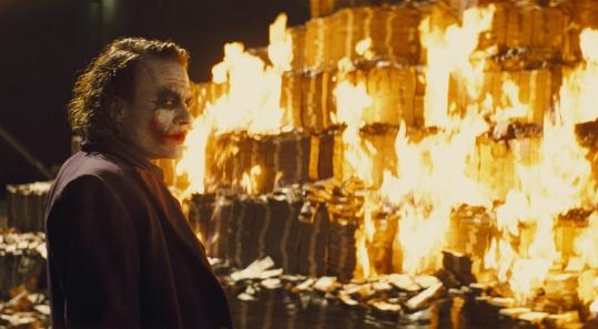 Joker Lights Money on Fire